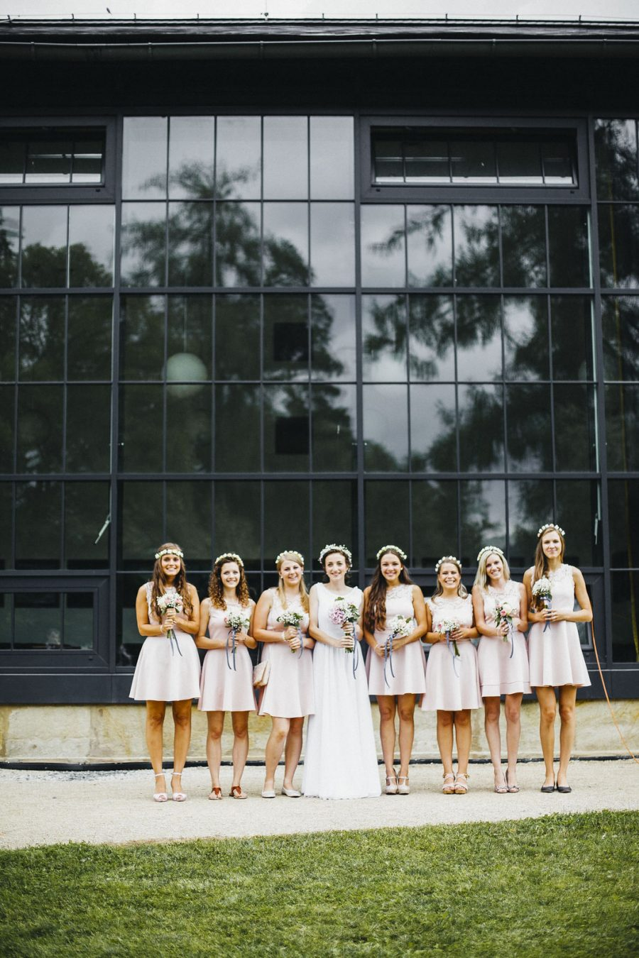 Bridesmaids in short pink dresses