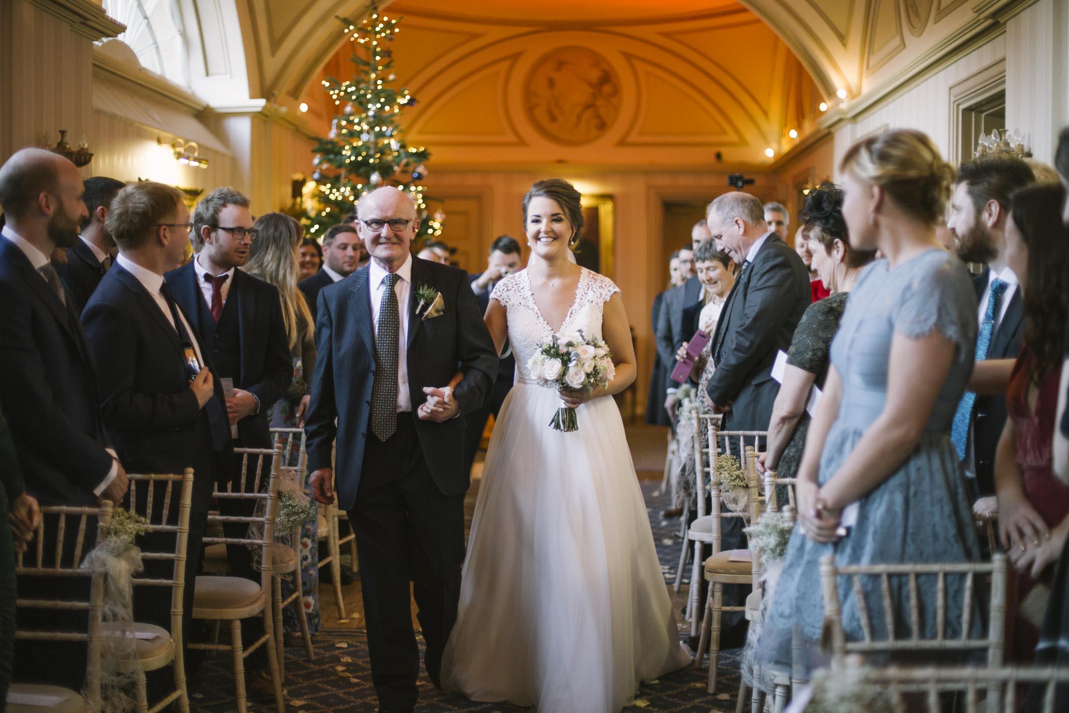 Bride walking down the aisle at Elegant Winter Balbirnie House Wedding by Ceranna Photography