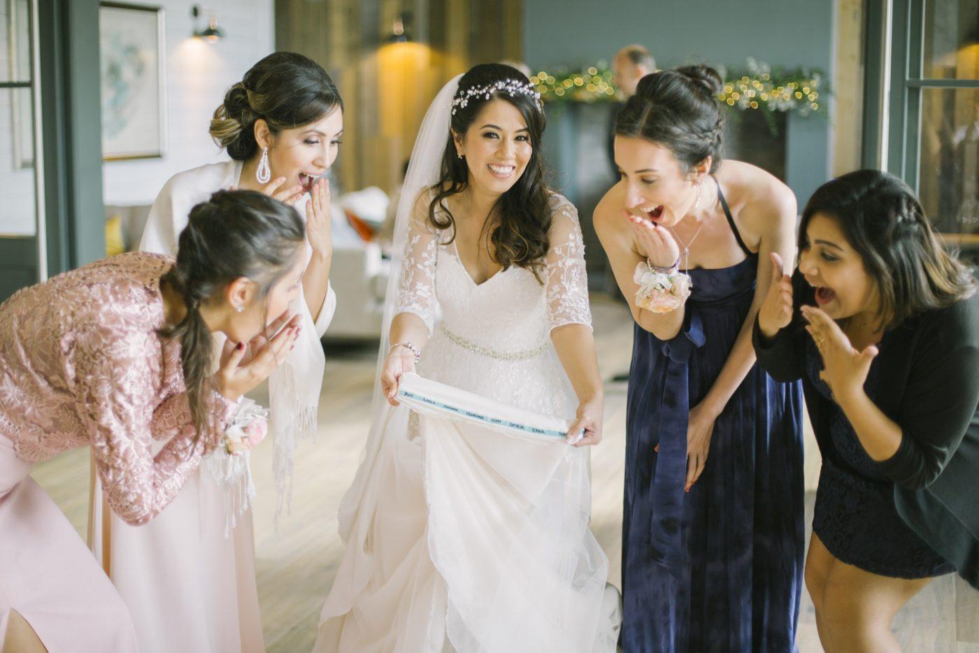 Brazillian wedding traditions   Single names in the hem of the dress   barn at bara