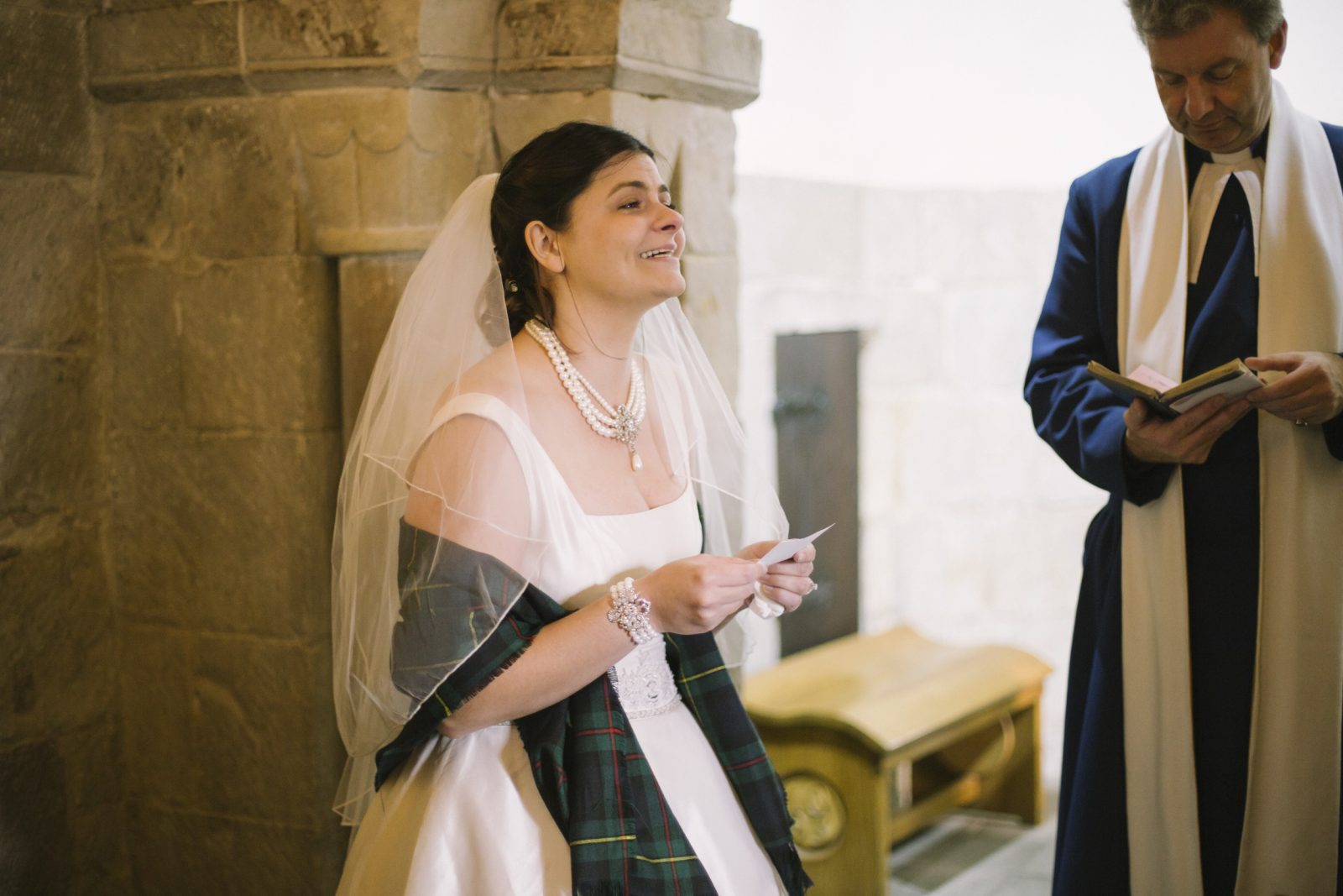 Faith reading her wedding vow | Edinburgh Castle Destination Elopement Photography | St Margarets Chapel Wedding