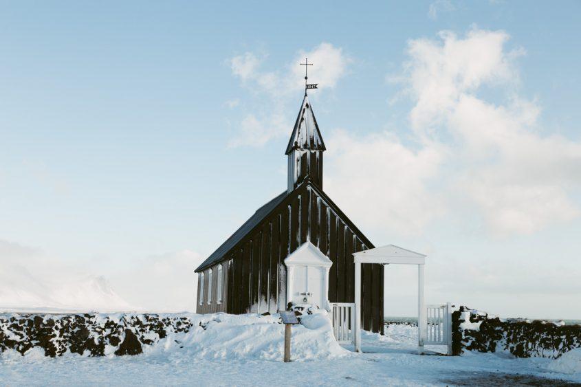 black church in iceland in winter