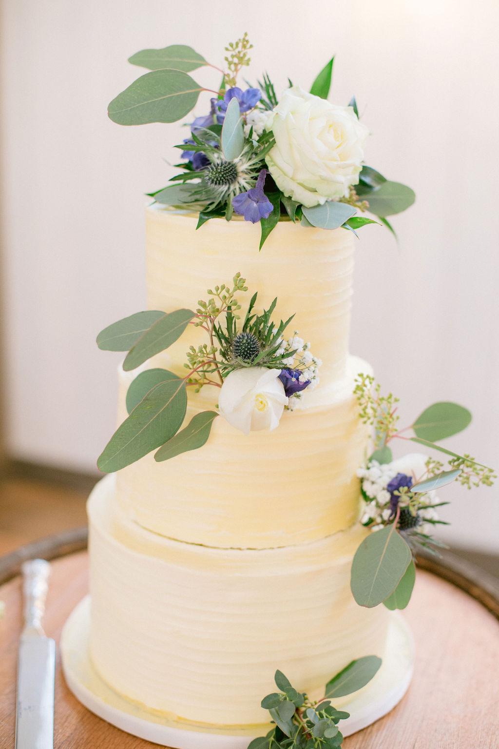 White wedding cake with eucalyptus