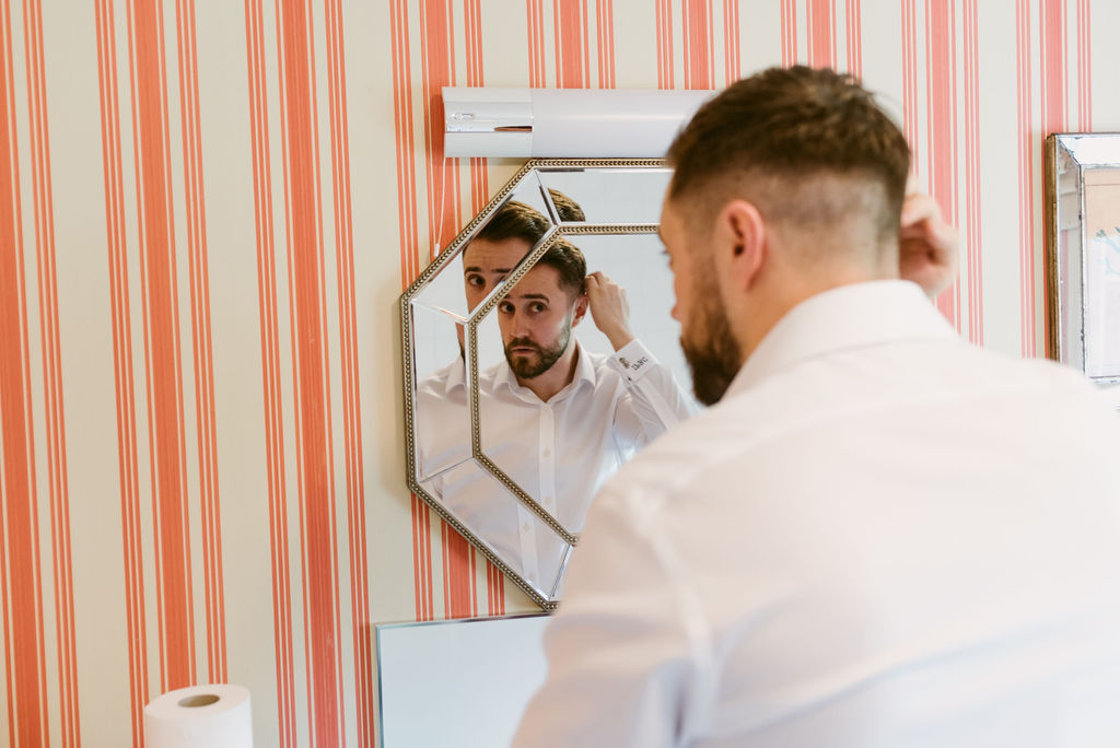 Groom getting ready at Elsick House Aberdeenshire