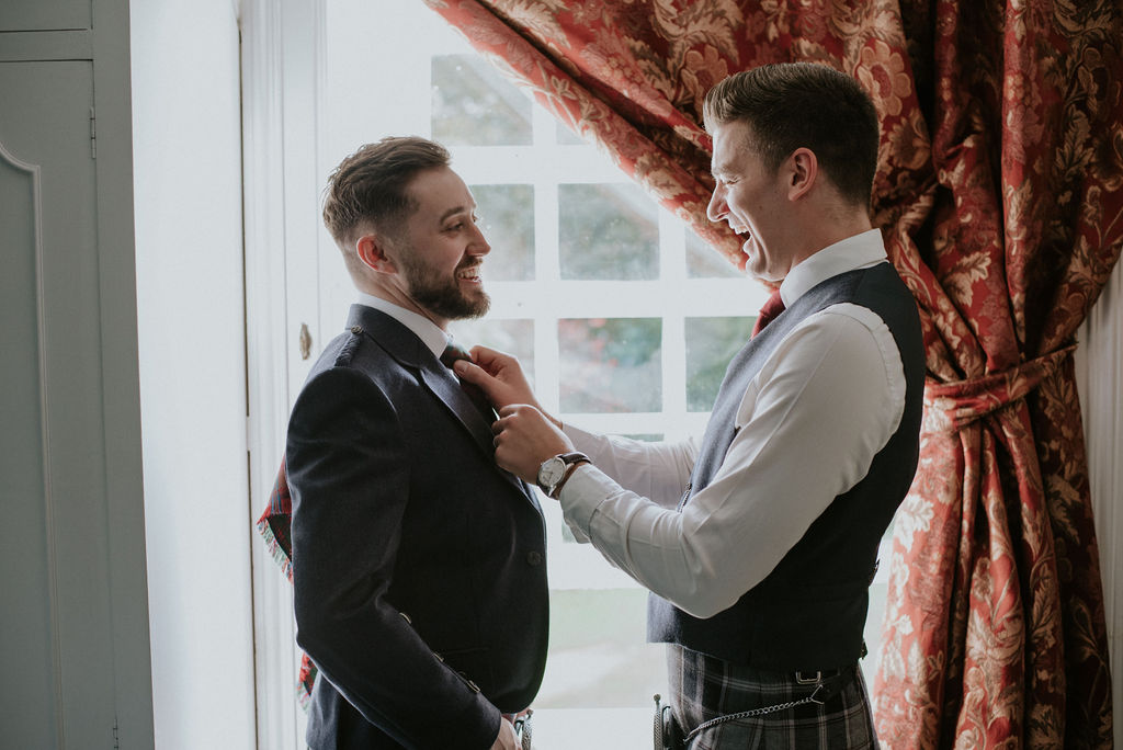 Groom getting ready at elsick House