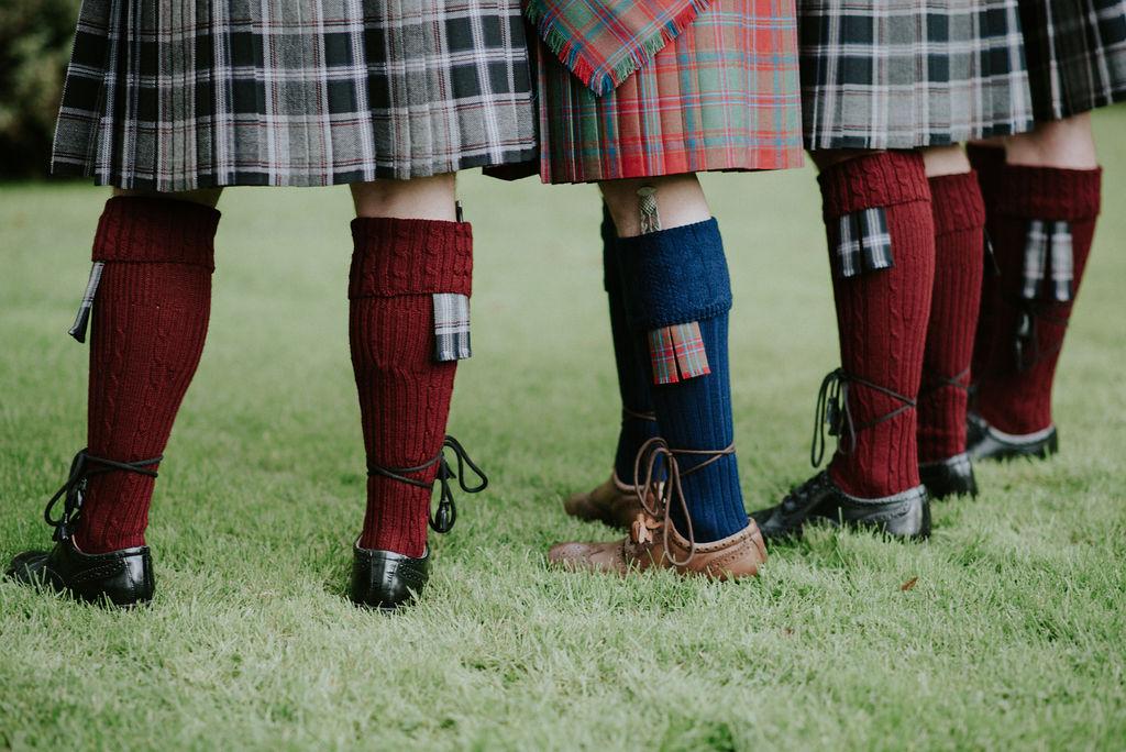 Groomsmen in kilts wedding detail