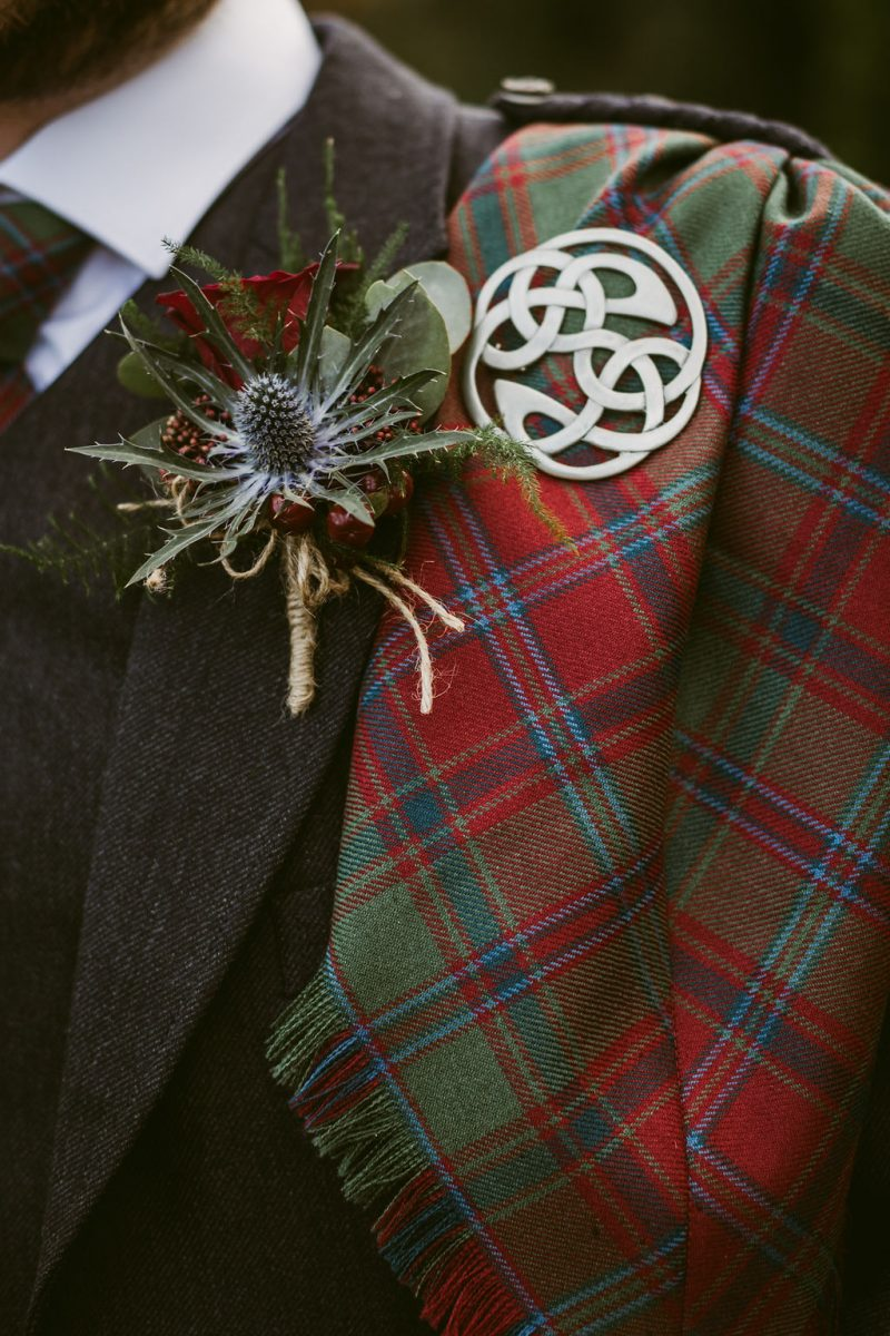 Burgundy tartan and thistle boutonniere and celtic ring | Elsick House Wedding