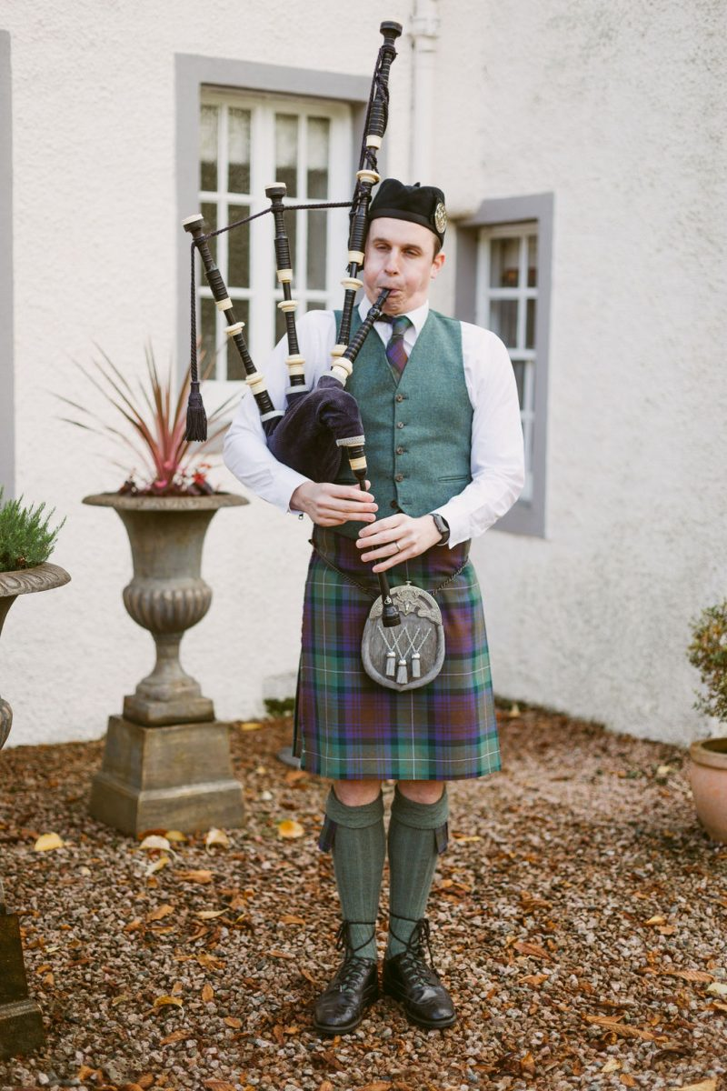 Scottish Bagpiper at Aberdeenshire Wedding | Elsick House
