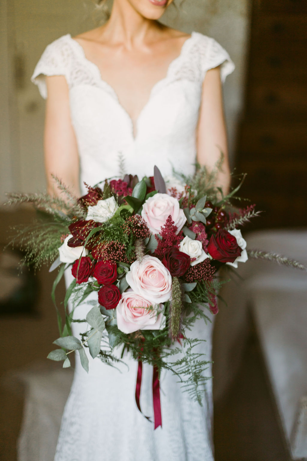 Flower Vogue Aberdeen | Elsick House Wedding | Burgundy red and pink roses wedding bouquet with eucalyptus | Ceranna Photography