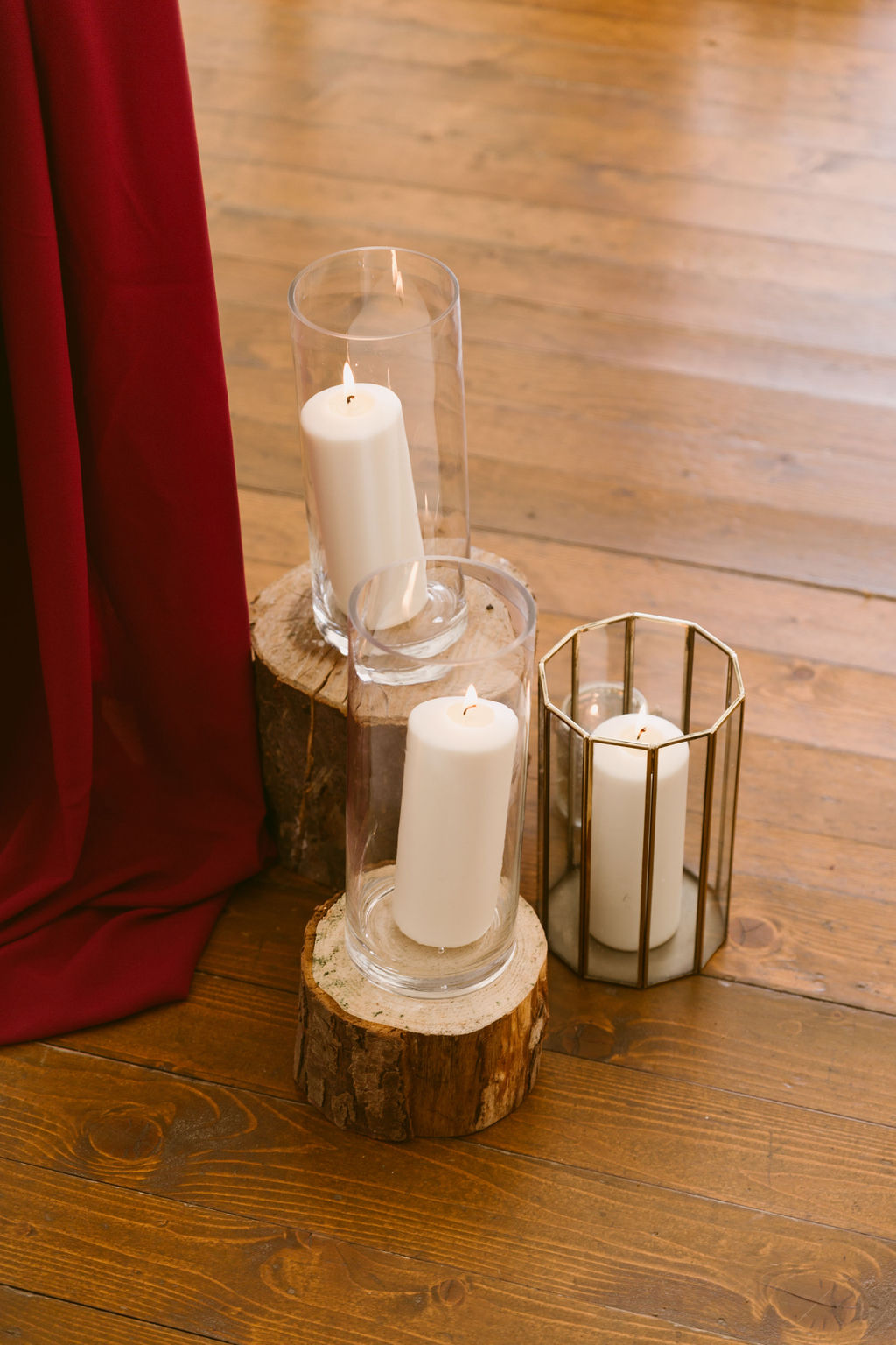 Wedding Arch Large White Candles and burgundy drapery