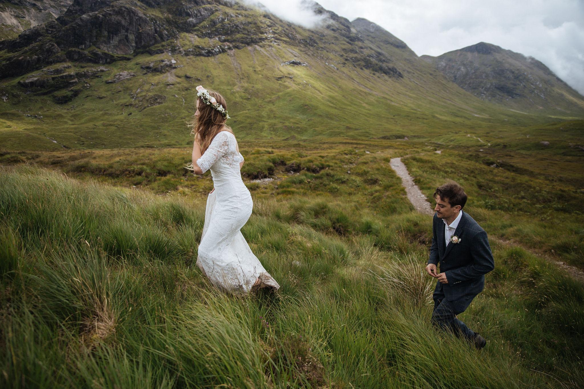 Dirty wedding dress hiking in Scotland