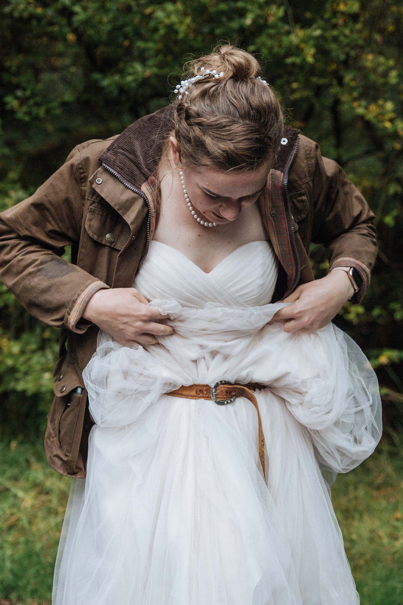 How to hike in a Wedding Dress - use belt to tie your dress round your waist